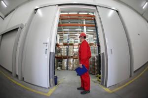 worker standing in the doorway of storehouse