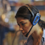 Vocollect_Female Worker Using SRX2 Headset CloseUp